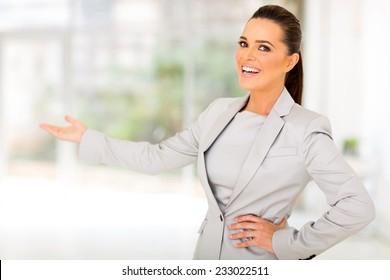 friendly businesswoman doing welcoming gesture