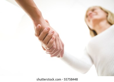 The friendly businesswoman  keeps women's hands in greeting when meeting