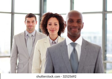 Friendly businesswoman in a line with her colleagues