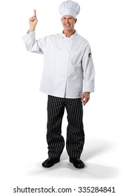 Friendly Caucasian Chef white in uniform pointing using finger - Isolated