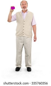 Friendly Caucasian elderly man with short grey hair in casual outfit holding business card - Isolated