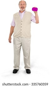 Friendly Caucasian elderly man with short grey hair in casual outfit holding phone placeholder - Isolated