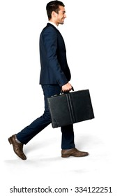 Friendly Caucasian man with short dark brown hair in business formal outfit holding briefcase - Isolated