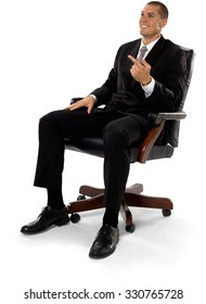 Friendly Caucasian man with short medium brown hair in business formal outfit with hands on thighs - Isolated