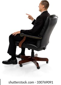 Friendly Caucasian man with short medium brown hair in business formal outfit with hands in lap - Isolated
