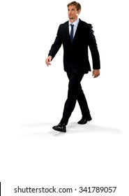 Friendly Caucasian man with short medium blond hair in business formal outfit walking - Isolated