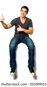 Friendly Caucasian young man with short black hair in casual outfit giving thumbs up - Isolated