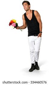 Friendly Caucasian young man with short medium brown hair in casual outfit holding flowers - Isolated