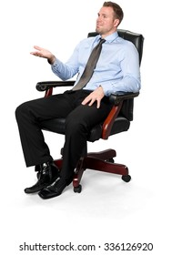 Friendly Caucasian young man with short medium brown hair in business formal outfit sitting in chair with hands on thighs - Isol