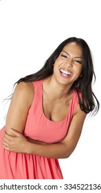 Friendly Caucasian young woman with long dark brown hair in evening outfit laughing - Isolated