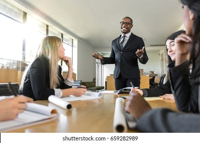 Friendly charming warm sales leader CEO giving briefing to his company executives in boardroom