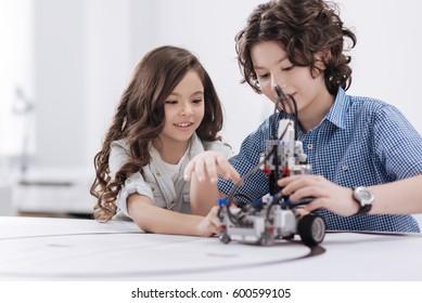 Friendly children using with modern technologies at school