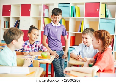 Friendly classmates chatting at break