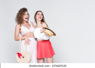 Friendly concept! Pretty, smiling  girls , wearing at casual summer style!
