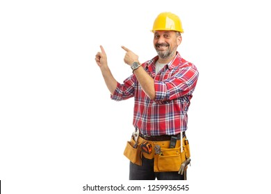 Friendly construction workman pointing with index fingers at blank copyspace behind isolated on white