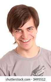 friendly dark-haired man smiling on white
