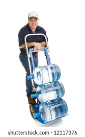 Friendly delivery man bringing 5 gallon water jugs on a hand cart.  Full Body isolated on white.