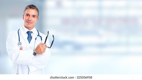 Friendly Family doctor man over hospital banner background.