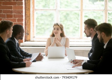 Friendly female boss holding office corporate meeting with diverse colleagues, woman executive ceo leading briefing with male team or partners discussing good work results and new project ideas