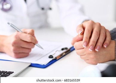 Friendly female doctor hold patient hand in office during reception. Examination result, positive test, calm down, promise and cheer up, grief and suffer, treatment, condolence, ethics, visit concept