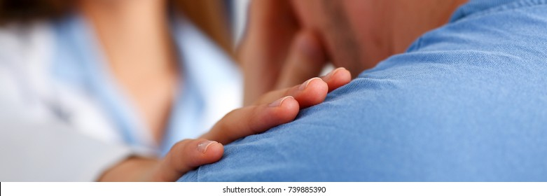 Friendly female doctor hold patient shoulder