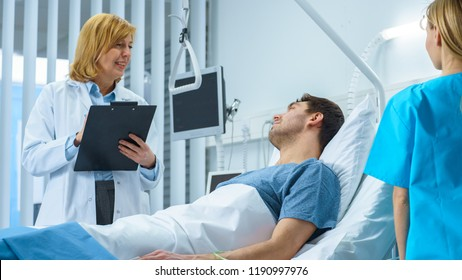 Friendly Female Doctor Visits Smiling Recovering Man who is Lying in Bed, She Asks Him Questions and Fills Medical Chart, Nurse Checks His Vital Signs.