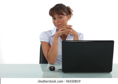 Friendly female sat at desk