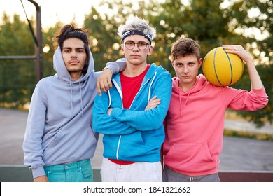 friendly group of caucasian teenagers boys ready to play basketball, athletic young guys full of energy and strength. people, youth, young generation concept