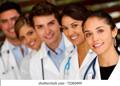 Friendly group of doctors in a row at the hospital