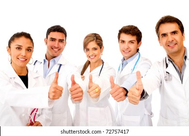 Friendly group of doctors with thumbs up - isolated over white