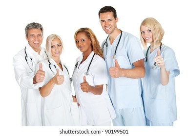 Friendly group of doctors with thumbs up isolated over white background