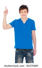 friendly guy in blue t-shirt pointing up. isolated on white background