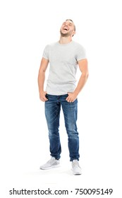 Friendly joyful man laughing out loud with his hands in pockets. Isolated on white background.
