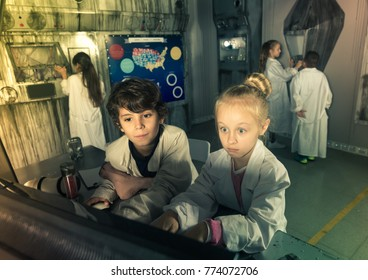 Friendly kids are concentrating on finding a way out of bunker quest room