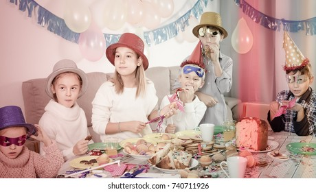 friendly kids having good time during friend`s birthday party