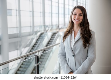 Friendly likable portrait of an executive business woman manager, advisor, agent, representative at office