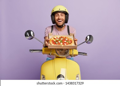 Friendly looking punctual pizzaman has good time management skills, arrives always in time, shows delicious pizza for customer, hopes for getting tip, wears yellow helmet, rides on fast motorcycle