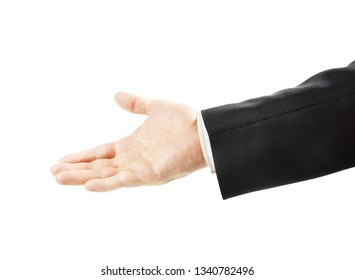 Friendly man in a suit reaches his hand out with an open palm up isolated on white background