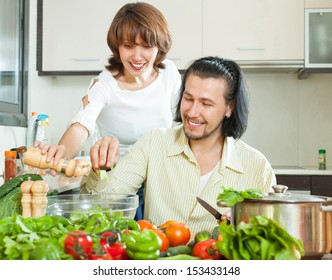 Friendly married couple preparing a meal of vegetables in your home