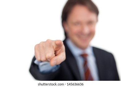 friendly mature businessman pointing his finger forwards