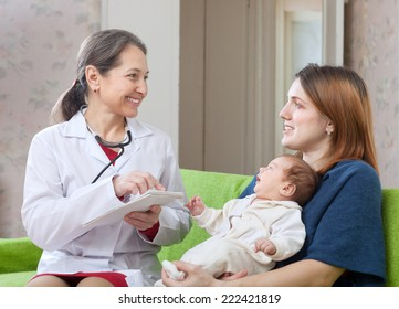 friendly mature pediatrician of prescribes to newborn baby the medication at home