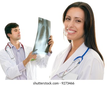 Friendly medical team.  Smiling female nurse or doctor and a male doctor holding up an x-ray
