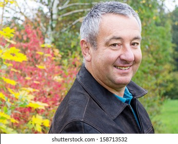 Friendly men portrait in autumn