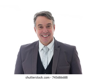 Friendly middle-aged man is smiling. He wears a suit and has gray hair. Isolated on white background.