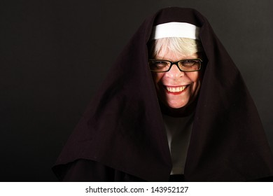 A friendly nun with a happy smile on her face.