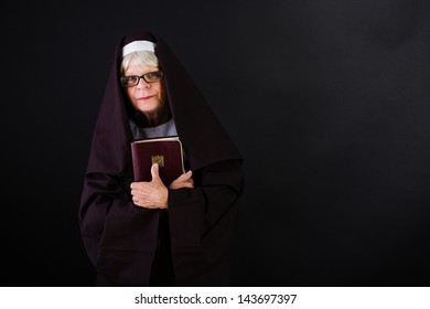 A friendly nun holding her bible