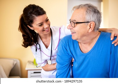 Friendly nursing home lady doctor with senior resident in elders people facility, nursing facilities concept