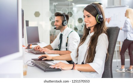 Friendly positive female business consultant, call center operator in call centre office