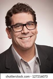 Friendly professional man with glasses closeup portrait