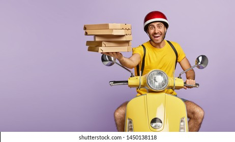 Friendly punctual pizza delivery man has nice time management skills, poses on motorbike, wears protective helmet, holds cardboard boxes of fast food, has excellent driving skills. Service concept